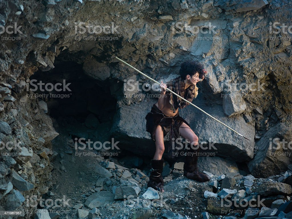 cavewoman hunting with spear stock photo