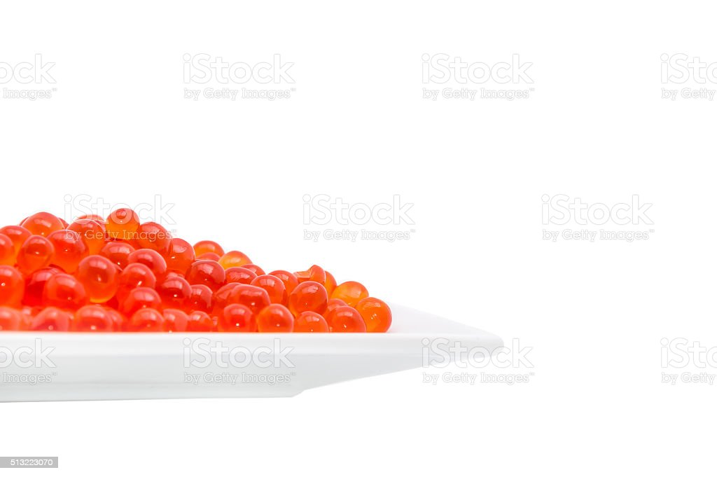 Caviar in a white plate isolated on white stock photo