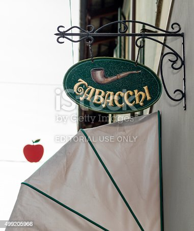 "Cavour, Piedmont, Italy - November 7, 2015: Sign of a tobacconist. Cavour is a little and elegant town in the plain near Pinerolo, at the foot of the western Alps. Every year, in November, Cavour hosts ""Tuttomele"", a regional show of apples (Piedmontese farmers grow more than 250 varieties of apples), fruit farming, wine, food and local craftworks. Cavour. Piedmont. Italy."