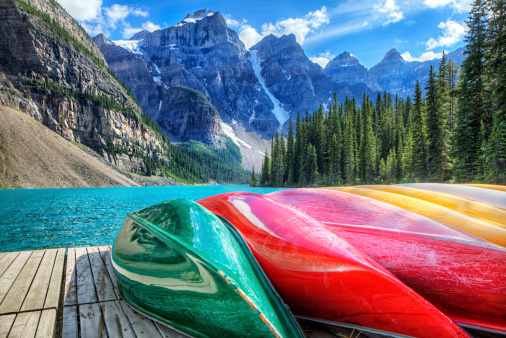 Colourful kayaks on the Moraine Lake, AB, Canada. HDR shot.