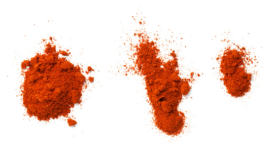 Cayenne pepper powder isolated on white background. Slight shadow. Top view, flat lay