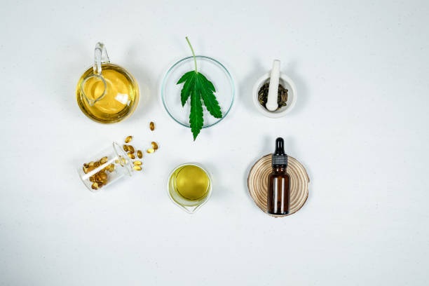 cbd thc oil medical treatment in doctor laboratory. natural medicine on clinical research . top view. cbd thc oil medical treatment in doctor laboratory. natural medicine on clinical research . top view. thc stock pictures, royalty-free photos & images