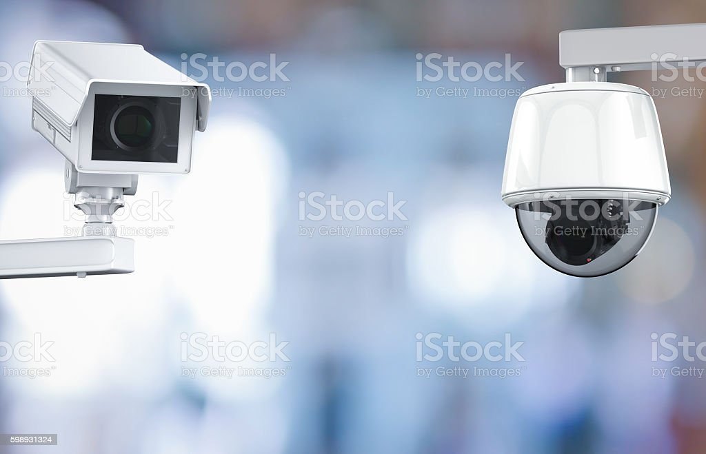 cctv camera or security camera on retail shop blurred background​​​ foto