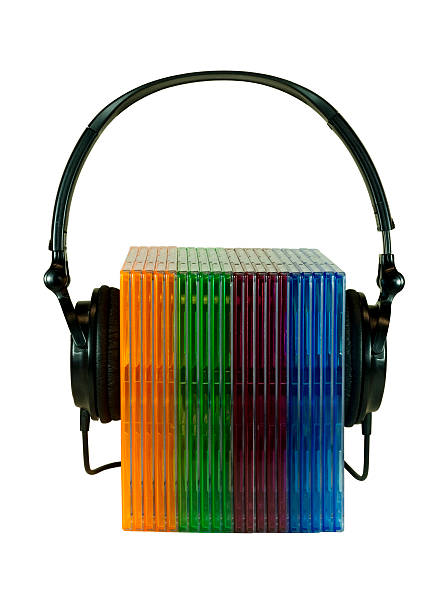 cd cases and headphones stock photo