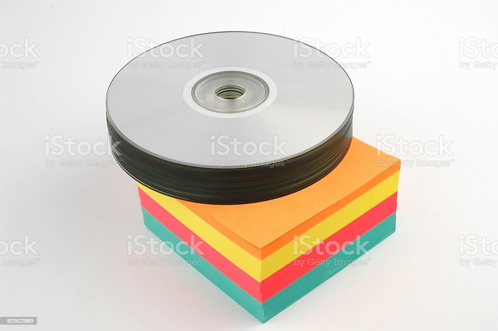 CDs on colorful notes royalty-free stock photo