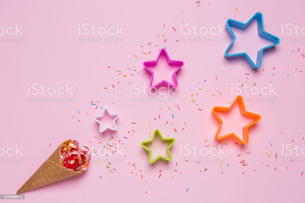 ce cream and decorations, candy and stars on a pink background stock photo