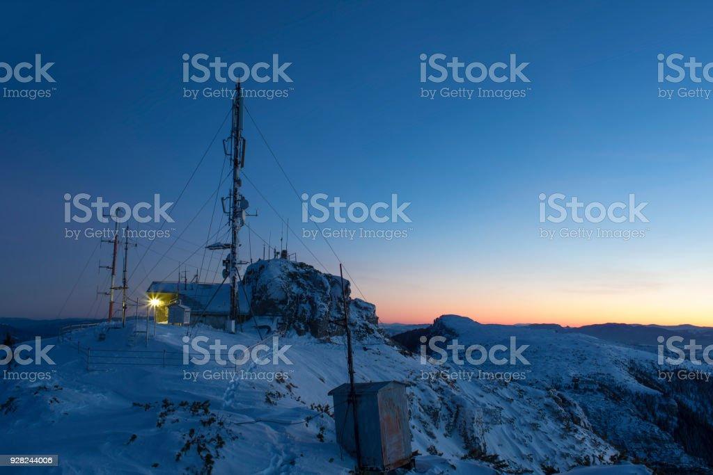 Ceahlau Toaca weather station in winter mountain landscape. Romania