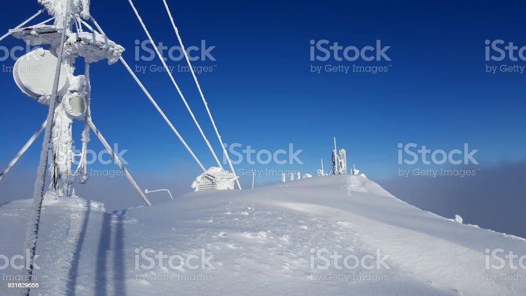 Ceahlau weather station in winter landscape. Romania