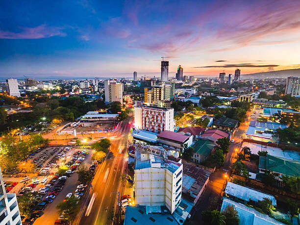 cebu city skyline during sunset - cebu stockfoto's en -beelden