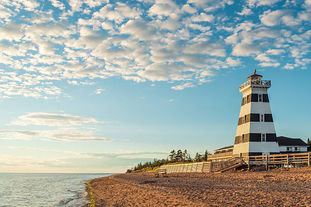 cedar dunes provincial park's lighthouse - prince edward island stock photos and pictures