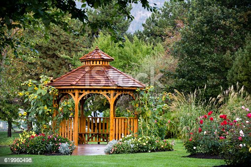 Cedar gazebo in a park at the Penticton Rose Garden located on the Trans Canada Trail in Penticton, British Columbia, Canada.