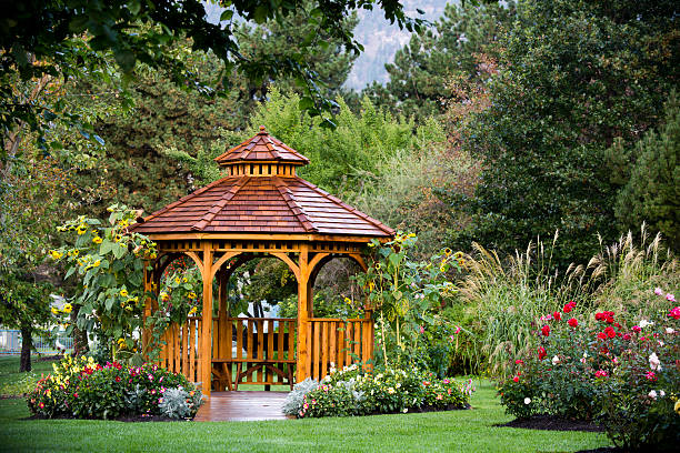 Cedar Gazebo Backyard Garden Park Cedar gazebo in a park at the Penticton Rose Garden located on the Trans Canada Trail in Penticton, British Columbia, Canada. pavilion stock pictures, royalty-free photos & images