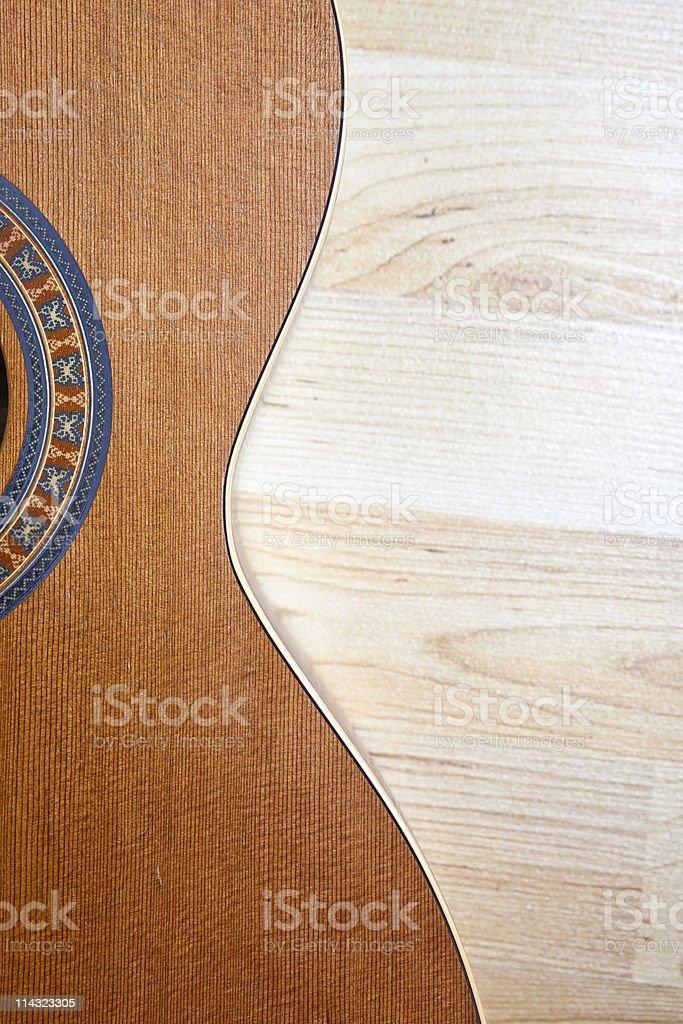 Cedar guitar against maple boards royalty-free stock photo
