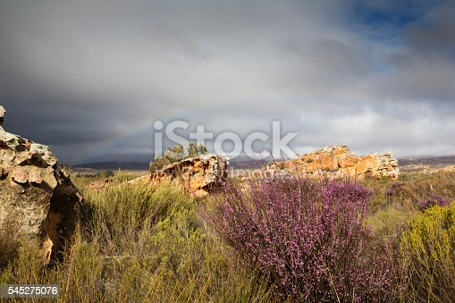 A rainbow over a rocky landscape in the Cederberg region of the Western Cape province of South Africa.