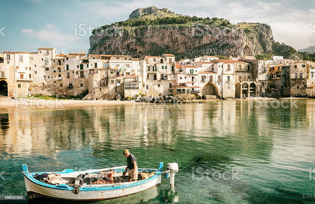 Cefalù, harbour and fisherman on boat stock photo