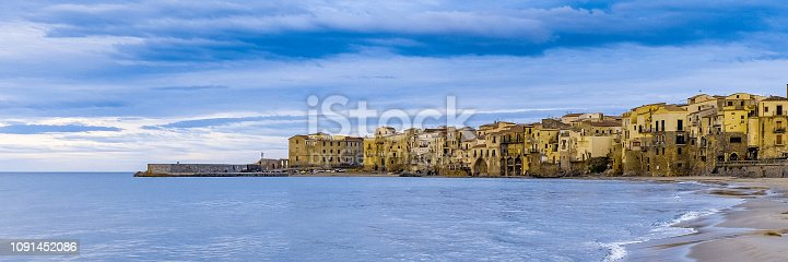 istock Cefalu old beautiful town beach view, Palermo region, Sicily. Wide banner 1091452086