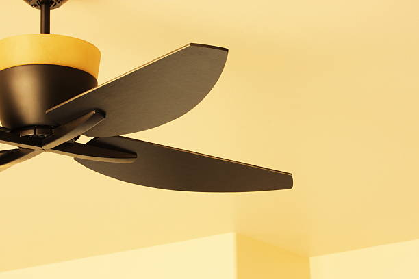 Ceiling Fan Blade Light Fixture Decor Contemporary ceiling fan and blades with light fixture, upscale home interior decor. ceiling fan stock pictures, royalty-free photos & images