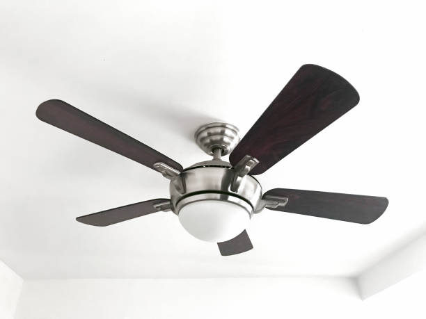 Ceiling fan Looking up to a ceiling fan ceiling fan stock pictures, royalty-free photos & images