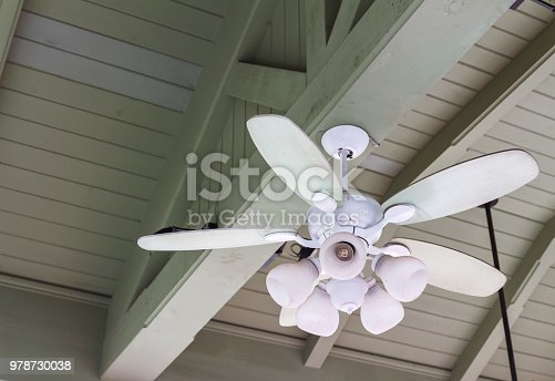 Ceiling fan with wooden ceiling lamp, vintage style