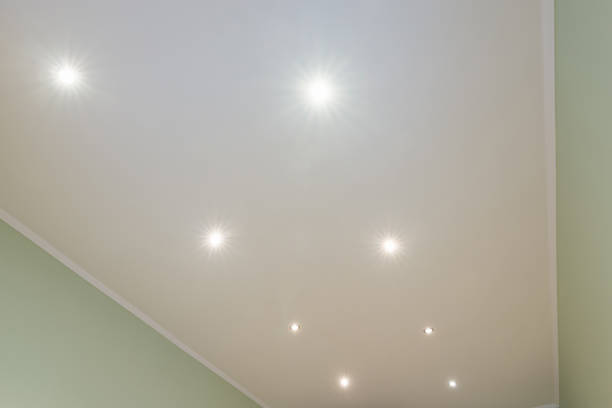 Ceiling in the room with spotlights installed and turned on Ceiling in the room with spotlights installed and turned on plaster ceiling design stock pictures, royalty-free photos & images