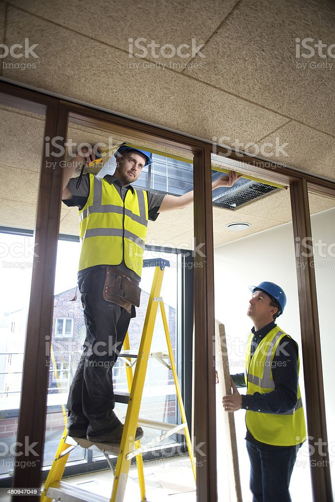 ceiling install stock photo