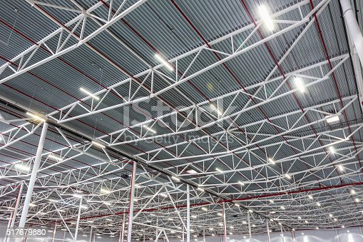 istock ceiling lamps with diode lighting in a modern warehouse 517679880