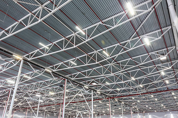 ceiling lamps with diode lighting in a modern warehouse - illuminated stock pictures, royalty-free photos & images