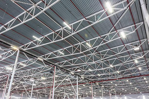 ceiling lamps with diode lighting in a modern warehouse - aydınlatılmış stok fotoğraflar ve resimler