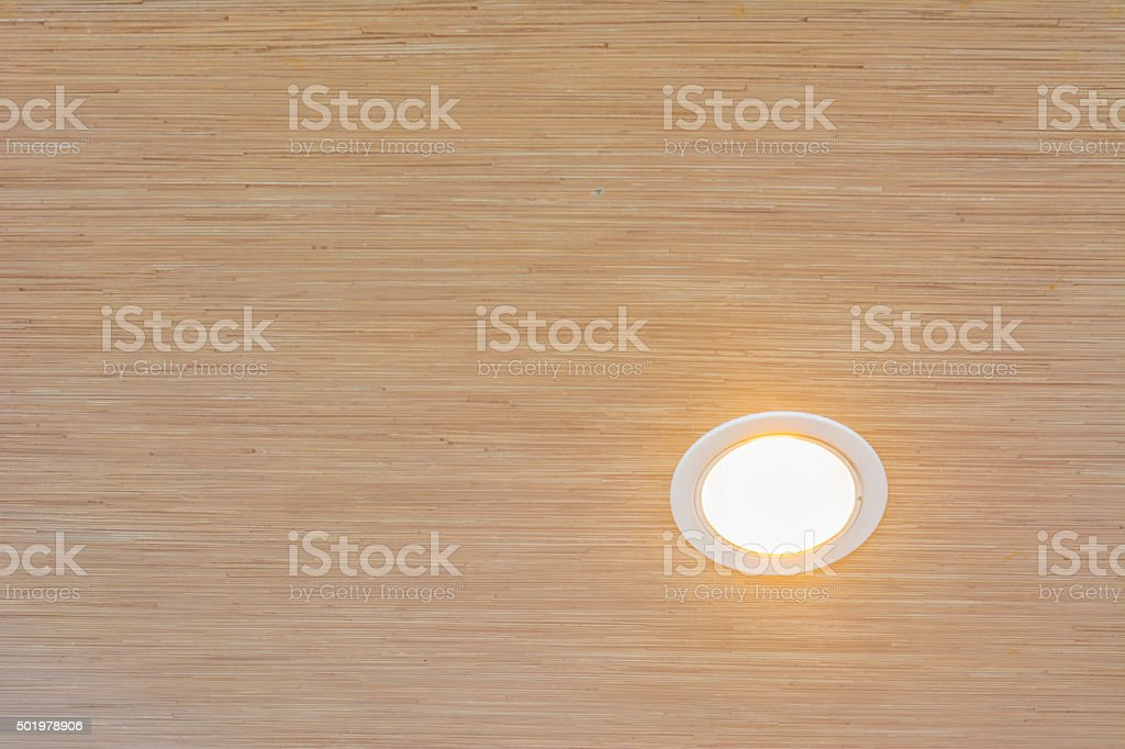 Ceiling light or downlight on wood wall background stock photo