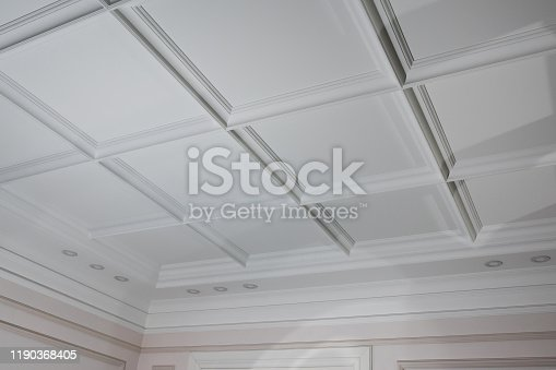 istock Ceiling moldings in the interior, detail of a angular ceiling skirting and lamps 1190368405
