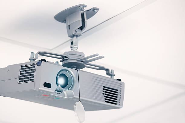Ceiling mounted projector Modern projector mounted in the ceiling. overhead projector stock pictures, royalty-free photos & images