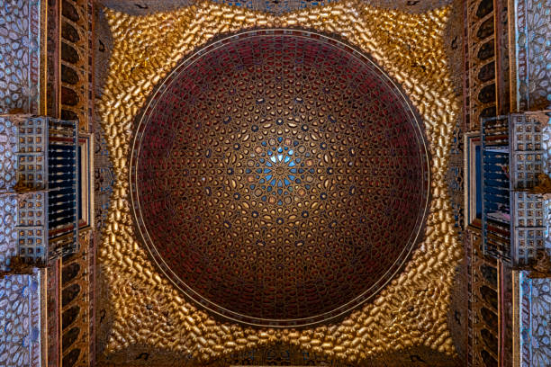 Ceiling of Real Alcazar palace in Seville Seville ( Spain ) 05/12/2018: Real Alcazar is a royal palace builted during the centuries in different styles due to the dominations. The rooms ceilings  shows the difference of architectural styles alcazar palace stock pictures, royalty-free photos & images
