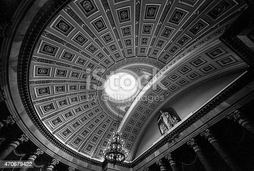 A wide angle view of the ceiling of the rotunda of the United States House of Representatives chambers in the US Capitol building that shows the ceiling panels and the oculus of the dome. (Scanned from black and white film.)