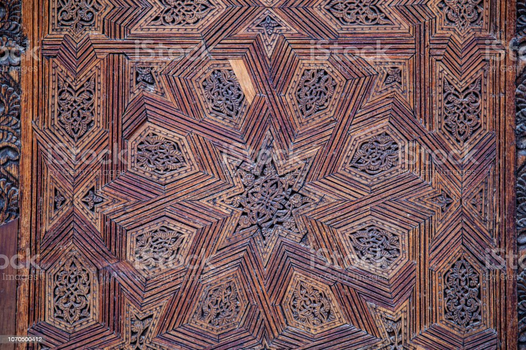 Ceiling with carved wooden pattern in Madrasa Bou Inania wooded stock photo