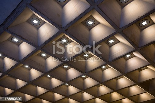 Decorative uniform illumination of the room by placing light sources in angled volumetric squares with a bulb at the base and conically diverging planes to the edge creates cozy soft lighting effect