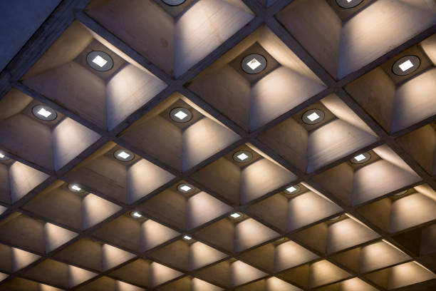 Ceiling with decorative geometric design with lighting in each square stock photo
