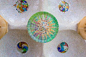 istock Ceiling with mosaic sun roof tile at Guell Park, Barcelona, Spain. 951046434