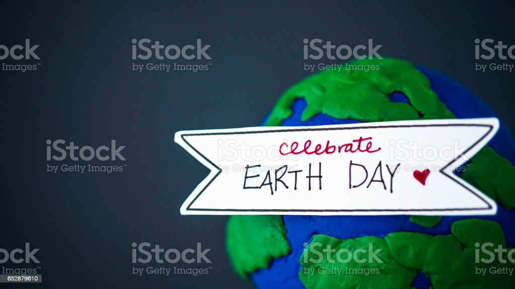 Celebrate Earth Day. Handmade globe with banner stock photo