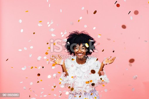 istock Celebrate happiness and joy- young girl throwing confetti 961865680