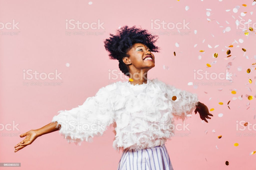 Celebrate happiness and joy- young girl throwing confetti foto stock royalty-free