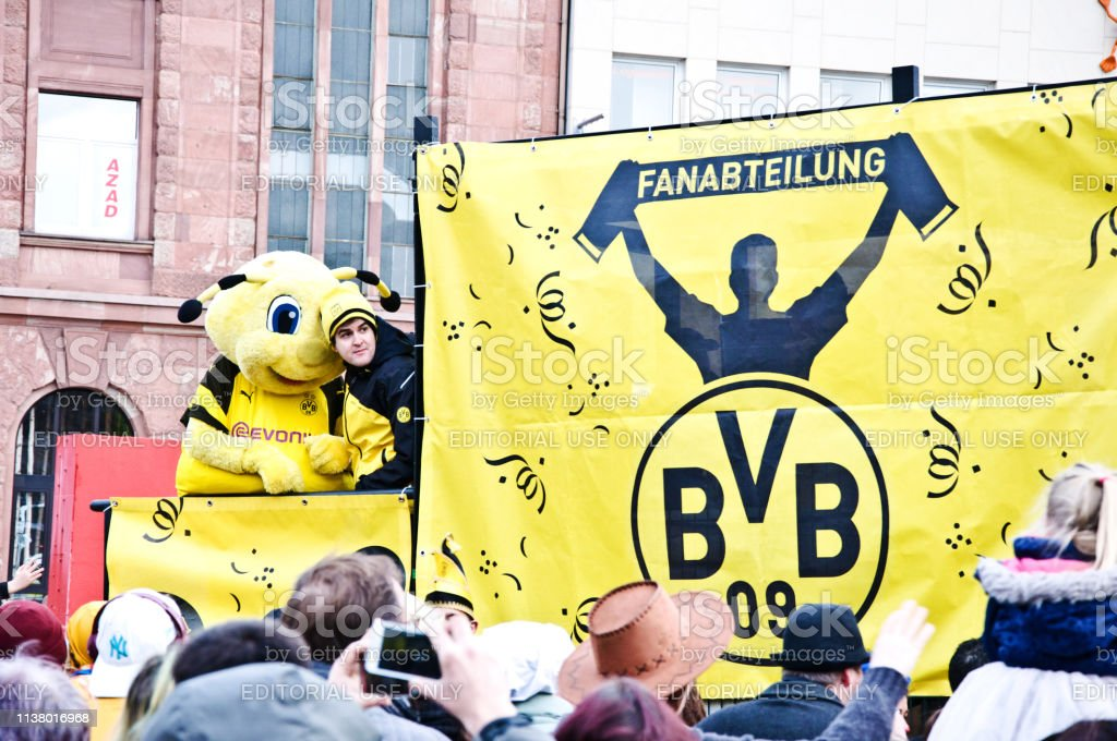 Celebrating 100 Years Of Borussia Dortmund Fc Legends At Dortmunder Rosenmontag Fans Tourists Enjoying The Clubs Parade Train With The Clubs Banner And Mascot On Kampstrasse At Dortmund Rose Monday Carnival Germany