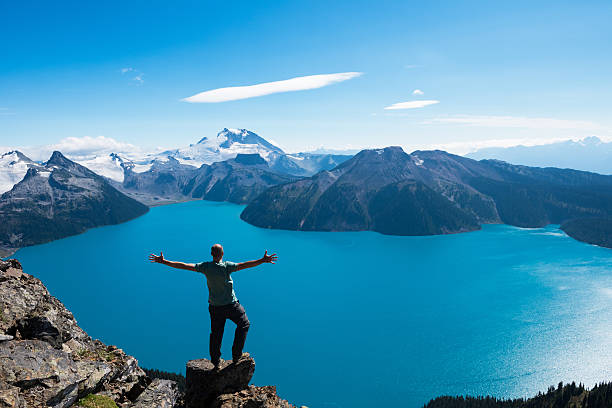 celebrating a personal victory in stunning nature - canada travel stock photos and pictures