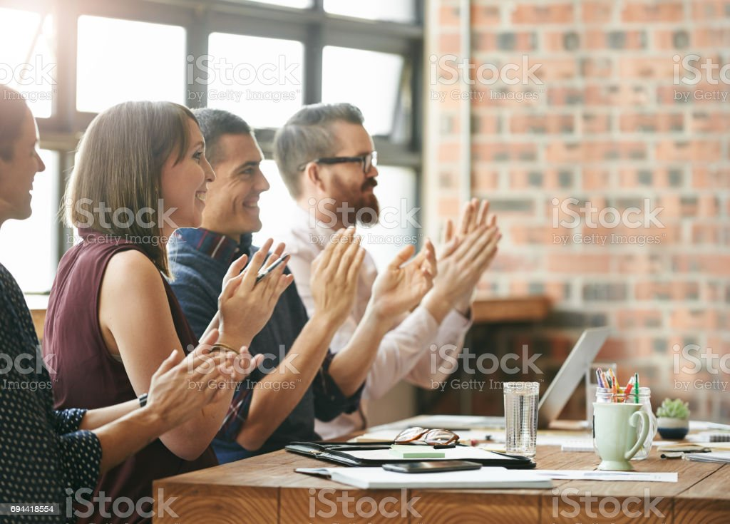 Celebrating another successful quarter stock photo