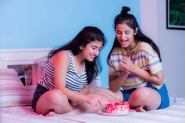 celebrating birthday at home stock photo Sister, Family, Bonding, Indian, Modern, at Home, Modern, Lifestyle, happy birthday stock pictures, royalty-free photos & images
