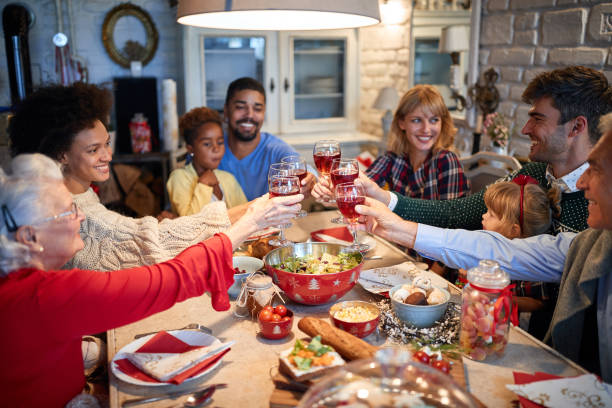Celebrating Christmas with red wine stock photo