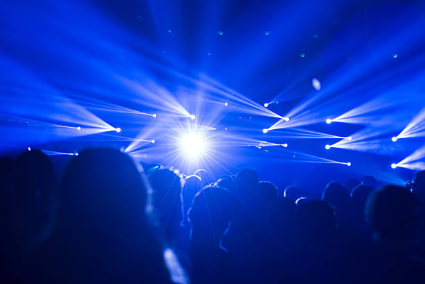 celebrating crowd with blue lights at a concert - festival - dansbana bildbanksfoton och bilder