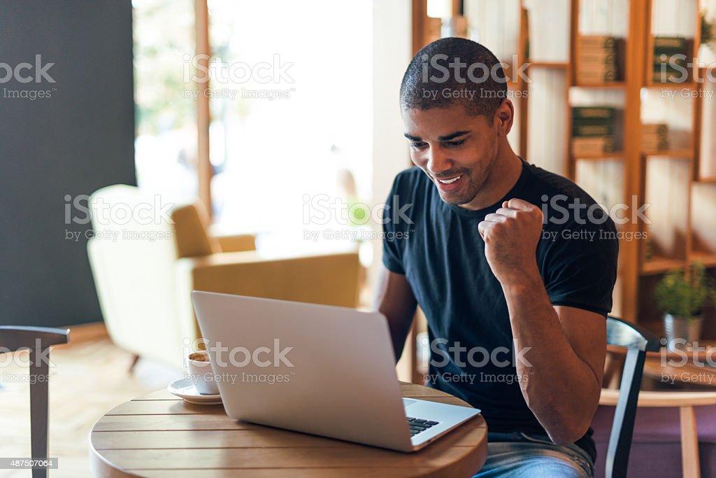 Celebrating his success stock photo