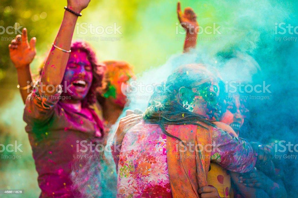 Celebrating Holi Festival in India stock photo