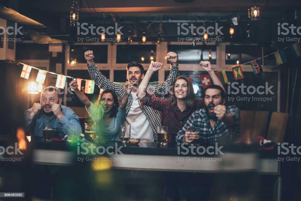 Celebrating in the pub stock photo