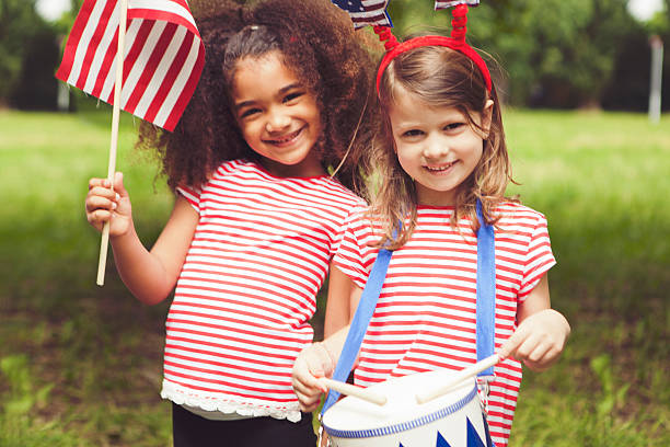 Celebrating independence day Children on Fourth of July or Memorial Day happy 4th of july photos stock pictures, royalty-free photos & images